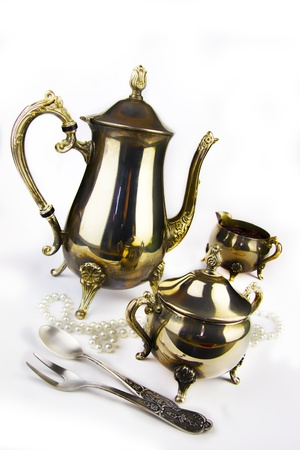 Ancient expensive coffee service on a white background photo