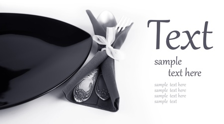 flatware: black plate with a fork and a spoon in a napkin  (With sample text)