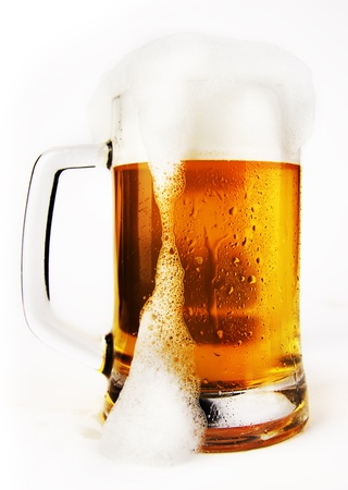 cold glass of beer with foam on a white background photo