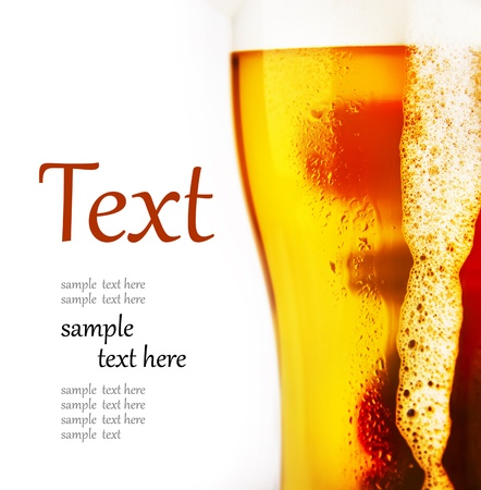 beer drinking: cold glass of beer with foam  (With sample text)