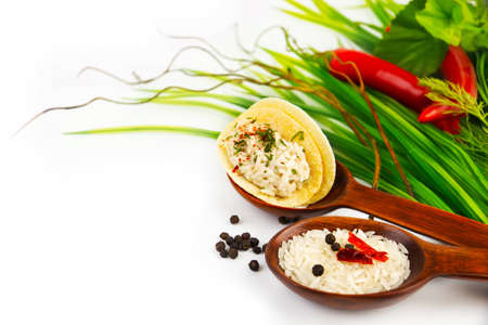 aliments: wooden spoons and ingredients on a white background