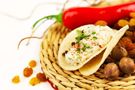aliments: portion of rice in a sauce with spices in a wicker napkin