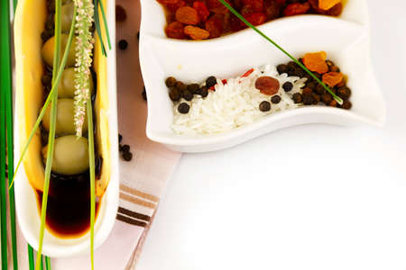 green olives in the sauce on ceramic plate Stock Photo - 12541018