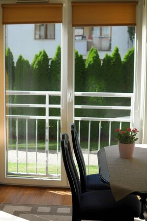Cozy warm summer interior. Dining room with panoramic windows. Modern interior minimalism