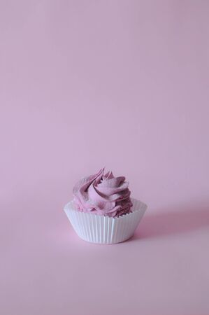 Homemade marshmallow berry zephyr on pink background in paper basket