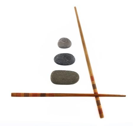chopsticks and stones isolated on white background photo