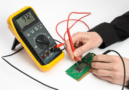 test probe: Testing electronic device. Measuring by multimeter