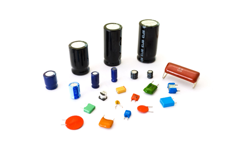 electrolytic: Various kinds of capacitors on the white background