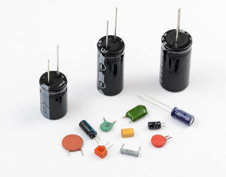 electrolytic: Various kinds of capacitors on white background