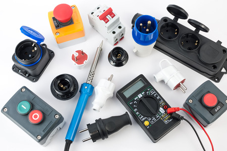 Electrical equipment and various tools on white background