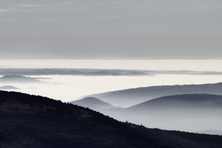 Foggy hills in a winter day photo