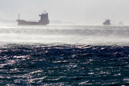 trieste: Container ships in the gulf of Trieste while a strong wind, known as bora, is blowing at 70 mph