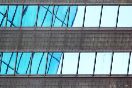 mirroring: Windows of an office building mirroring a nearby building