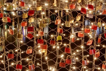 salzach: SALZBURG, AUSTRIA - DECEMBER 25, 2013  love padlocks placed by loving couples on a fence of the Makartsteg  Makart