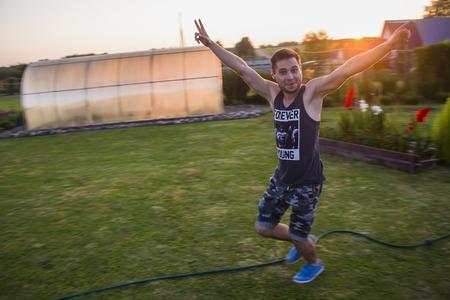 lucky guy runs across the grass toward the open hands