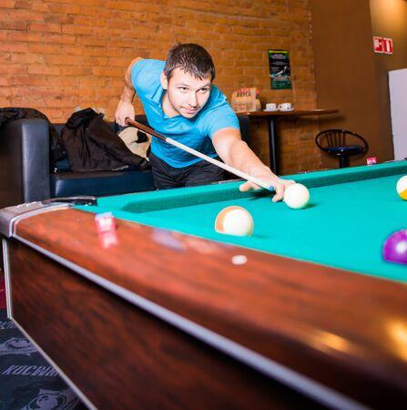 Russia,Krasnodar 19 November 2018-a man playing Billiards in the shopping center Редакционное