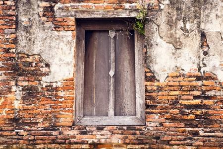 idolatry: old wood window at what phutthaisawan temple ayutthaya, thailand. Stock Photo
