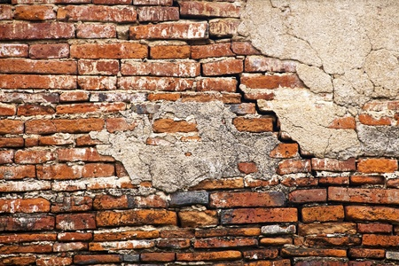 ruined: cracked brick wall