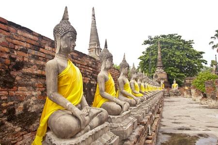 idolatry: Old Buddha Statue in Wat Yai Chaimongkol Temple Ayutthaya , Thailand. Stock Photo