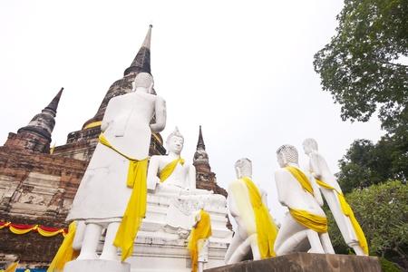 idolatry: White Buddha Statue in Wat Yai Chaimongkol Temple Ayutthaya , Thailand. Stock Photo
