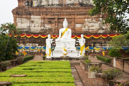 chaimongkol: White Buddha Statue in Wat Yai Chaimongkol Temple Ayutthaya , Thailand. Stock Photo