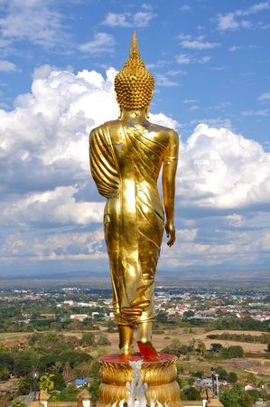 Buddha Standing Color Gold in Cloudy Day photo
