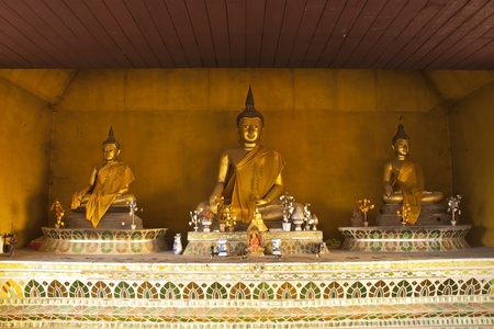 Three Buddha statue at temple in Nan Province, Thailand photo