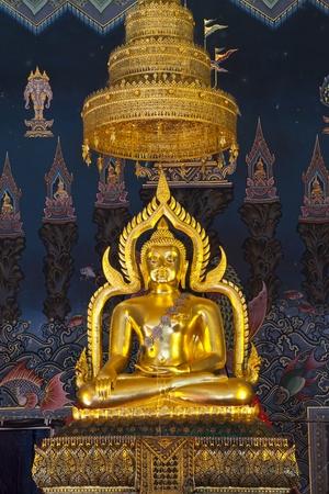 Golden Buddha statue inside a temple. Stock Photo