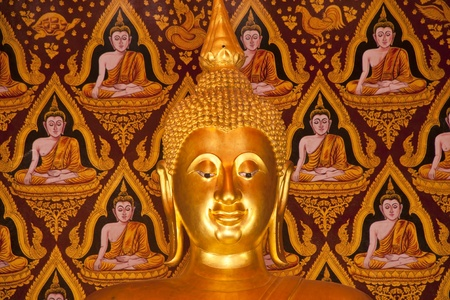 Close- up Golden Buddha in Temple photo