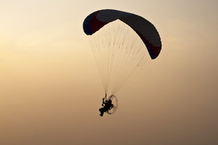 silhouette of para motor glider photo