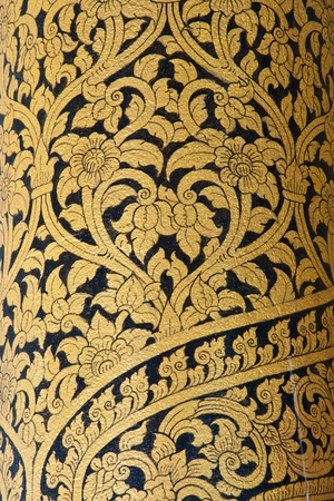 Thai art wall pattern in Temple of Thailand.The temple is open to the public and has beautiful murals on the walls. photo