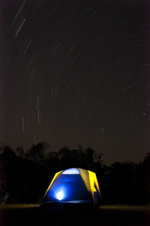 Illuminated Camping tent at Night photo