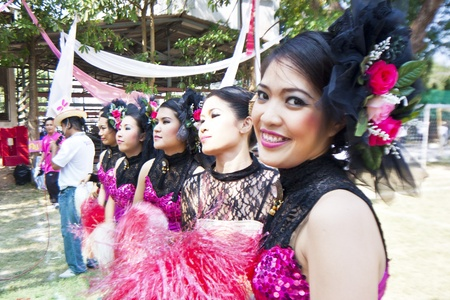 Cheerleaders rising pom-poms, (portrait) at Nan Province of thailand
