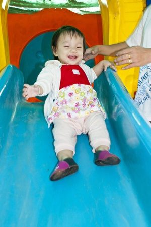 A Happy Little baby girl in playground Stock Photo - 11710657