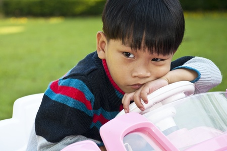 A little Boy in Car Toy pink color Stock Photo - 11708184