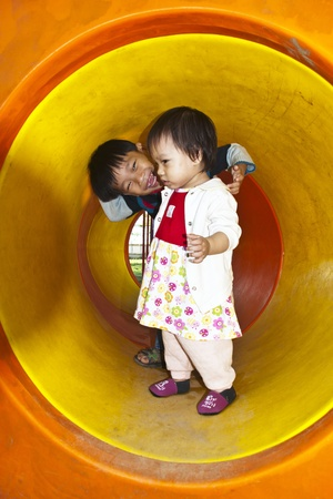 A little Boy and girl in Playground Stock Photo - 11710658