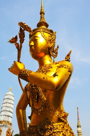 Physical gold statue in thai temple, Thailand photo