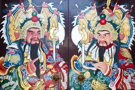 Traditional type of temple gate in China Town Thailand. God of China on the door photo