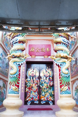daunting: Traditional kind of house gates in China and Twin Dragon in Chinese temple