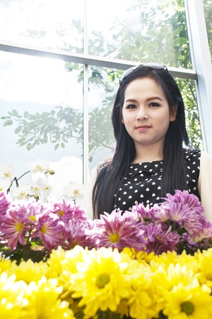 boater: Asian woman a flower in the garden Stock Photo