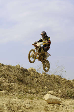An unidentified rider participates in the final round of motocross Nan Province 2012 Thailand