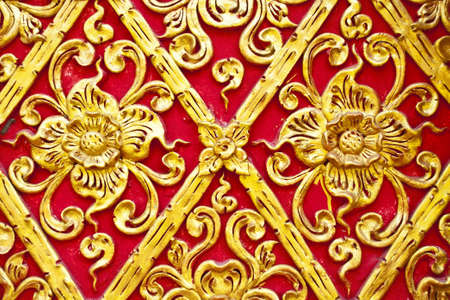 The gold stucco design of native thai style on the Wall photo