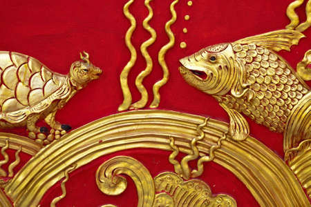 The gold stucco design of native thai style on the Wall Stock Photo - 12743043