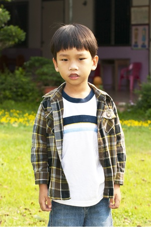 Asian little boy playing and calling Smart-phone Stock Photo - 12950745
