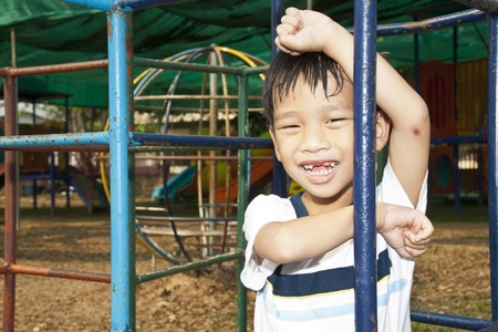 Asian Kid Playing In Playground Stock Photo - 13249280