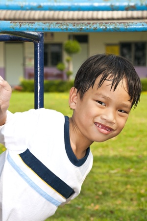 Asian Kid Playing In Playground Stock Photo - 13249272