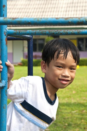 Asian Kid Playing In Playground Stock Photo - 13249279