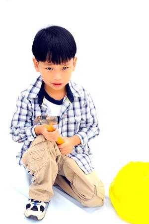 Asian Little boy with tools - isolated on white background photo