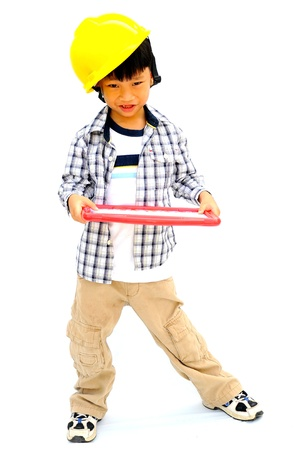 Portrait of a Asian little boy with a safety helmet photo