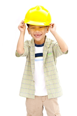 child with a yellow helmet isolated on white background photo